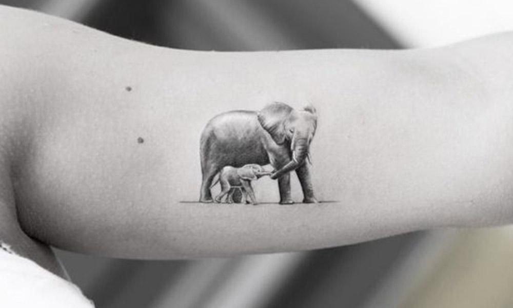 realistic tiny elephant tattoo